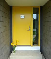 GI modern yellow door. gray siding