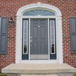 GI. grey front door.shutters match