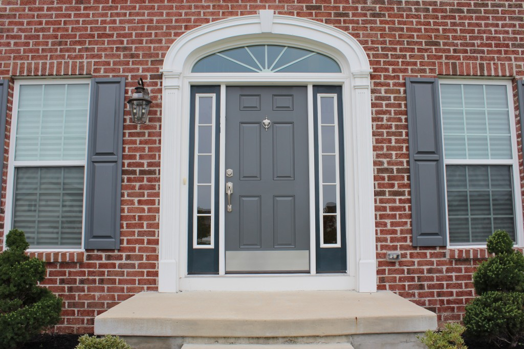 GI. grey front door.shutters match